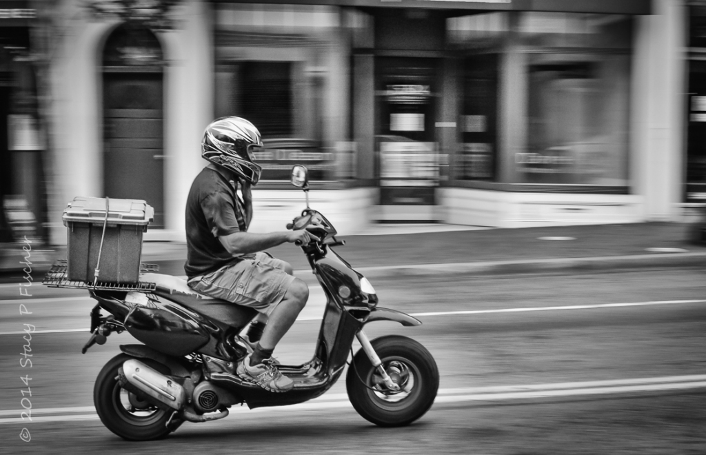 Movement of motorcycle caught via panning technique
