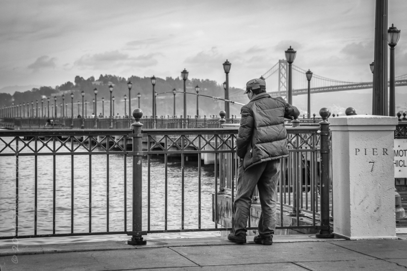 Fisherman at Pier 7, San Francisco, with Oakland Bay Bridge in the background