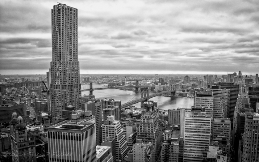 Skyline, Manhattan and Brooklyn Bridges span the East River connecting Lower Manhattan to Brooklyn