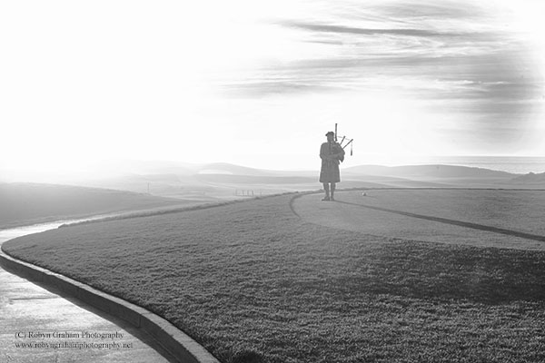 Bagpipe Player at Sunset