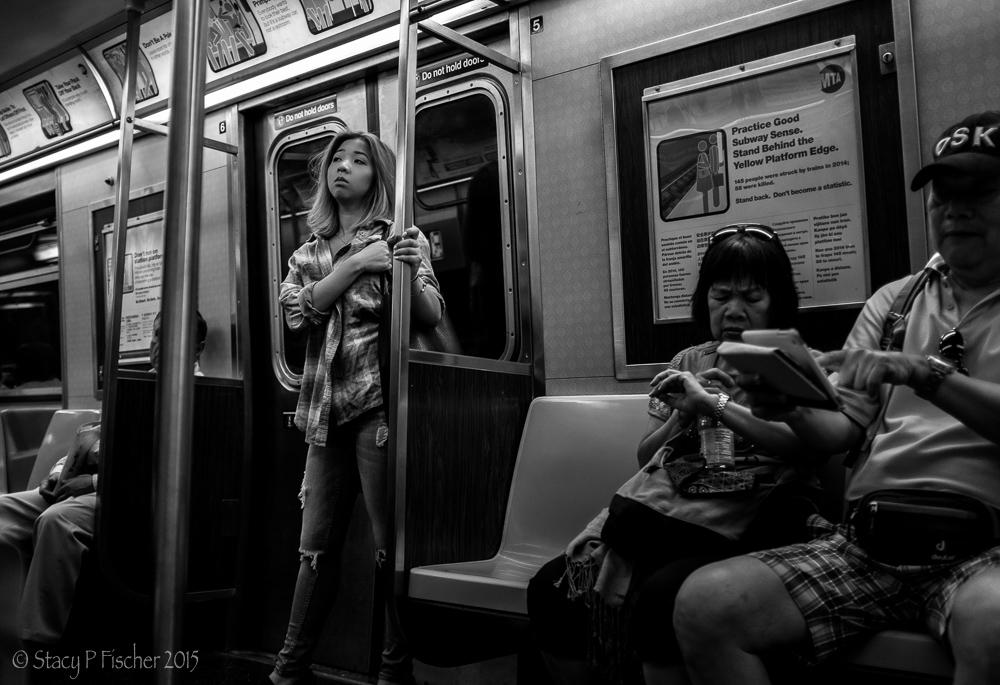 Wistful female passenger on New York City subway