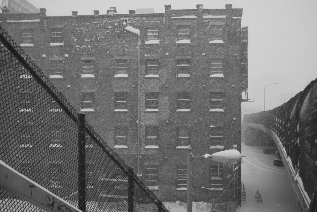 Bronx building and bridge with snow