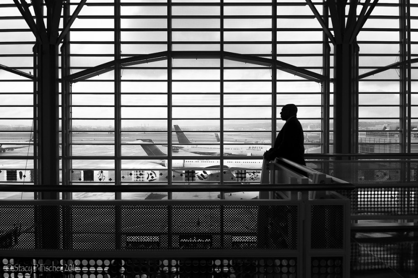 Man silhouetted against windows at Washington National Airport