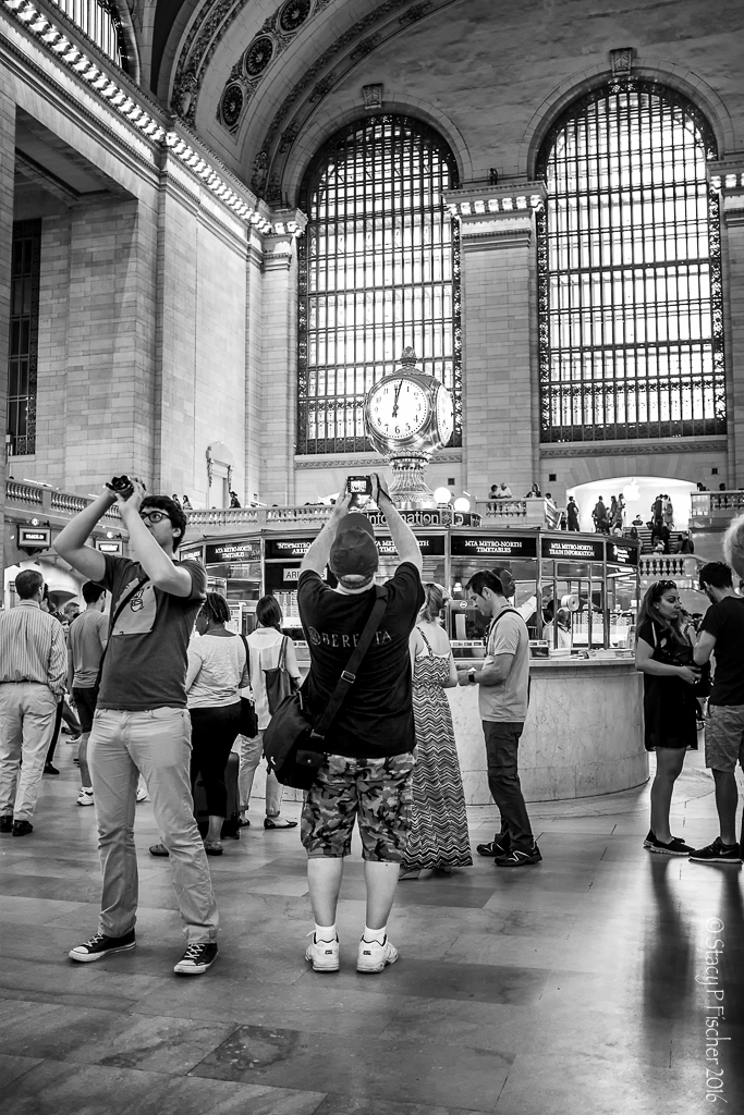 People photographing interior of Grand Central Station New York City