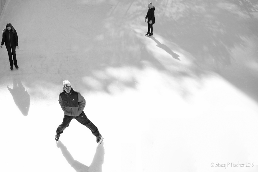 Ice skaters and their shadows